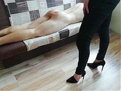 Amateur hard caning on sofa by a lady in black pants